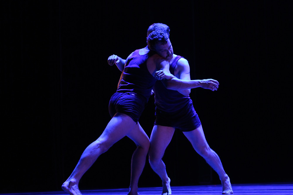 Dancers Gareth Belling and Michael Smith grapple with each other during Turbine.