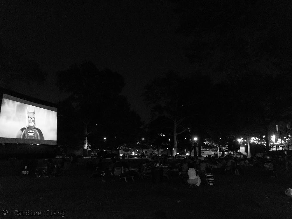 Community watching the Batman Lego movie in a park near Chinatown in Philadelphia