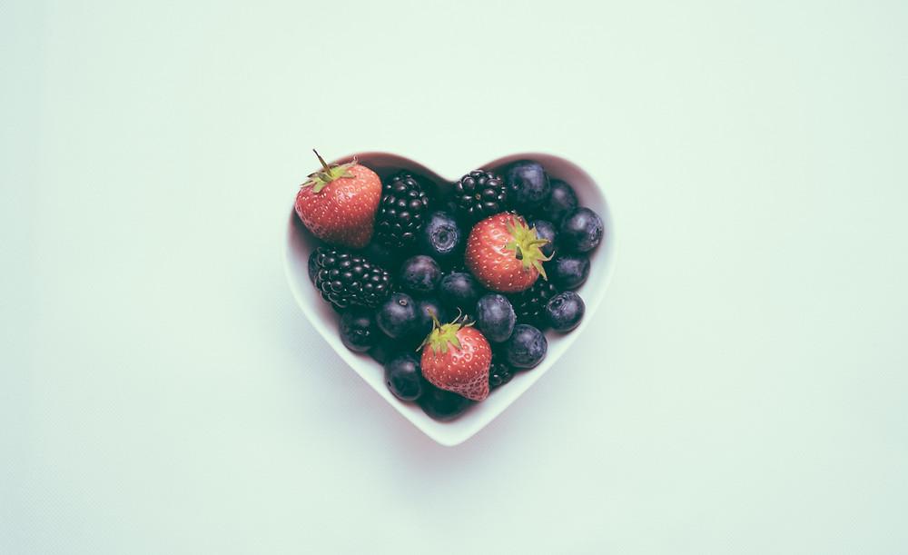 Heart-shaped bowl of fruit