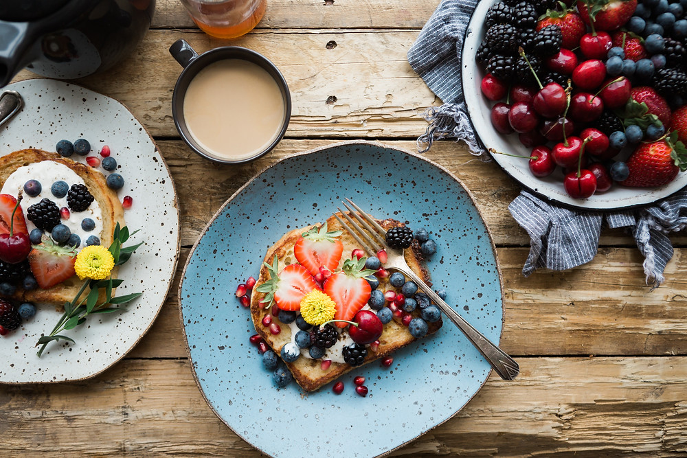 Plates of toast and fruit