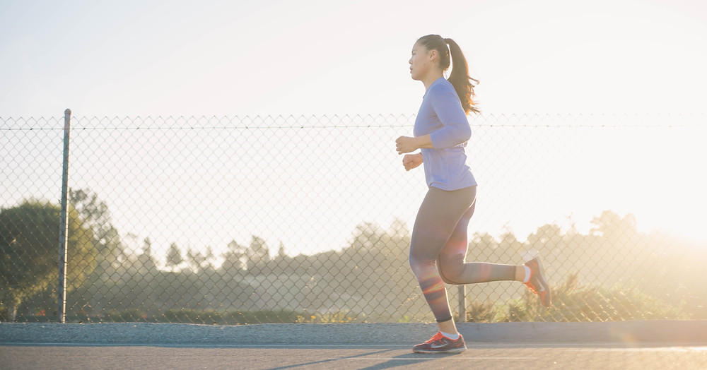 Woman doing cardio by running