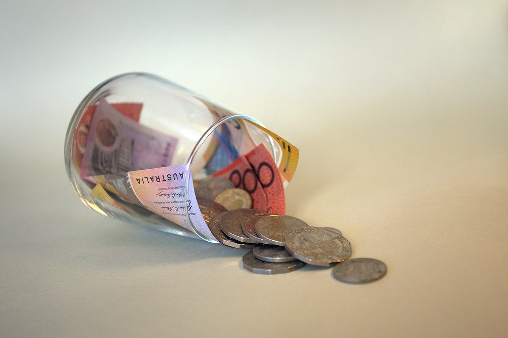 Jar with coins and money