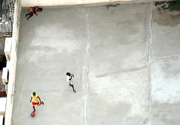 Men playing basketball on roof