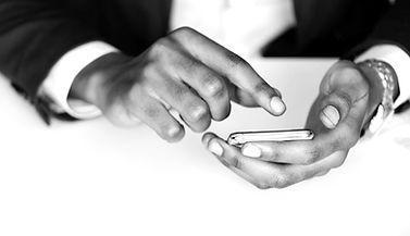 blur-businessman-cellphone-943628_edited