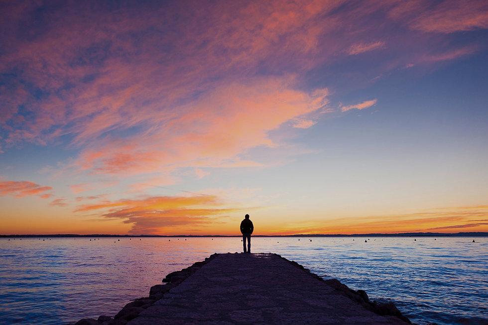 person-on-dock-sunset-165085322_edited.jpg