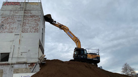 Excavator on a dirt ramp