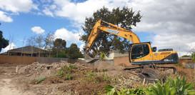 Excavator sorting soil