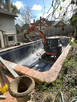 Demolition Machine in a Swimming Pool