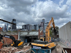 Two Demolition Machines Working Together