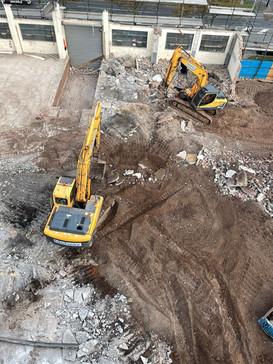 Demolition with two excavators