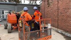 Demolition workers Inside A Cherry Picker