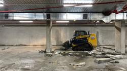 Bobcat removing underground carpark