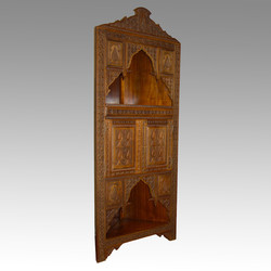 Hand carved corner cabinet