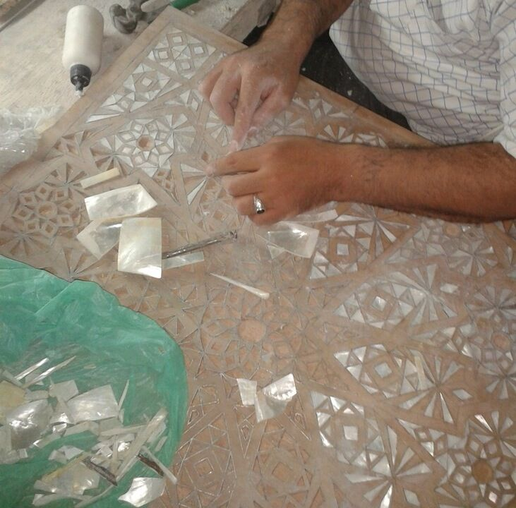 A craftsman inlaying mother of pearl