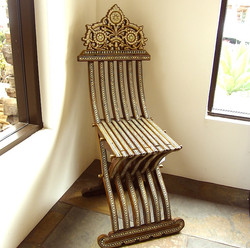 Folding mother of pearl chair