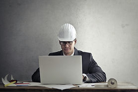 engineer-working-with-laptop-at-table-3769135.jpg