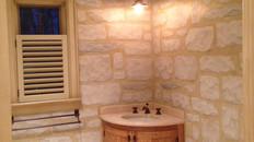 Trompe l'oeil stone and woodgrain master bath