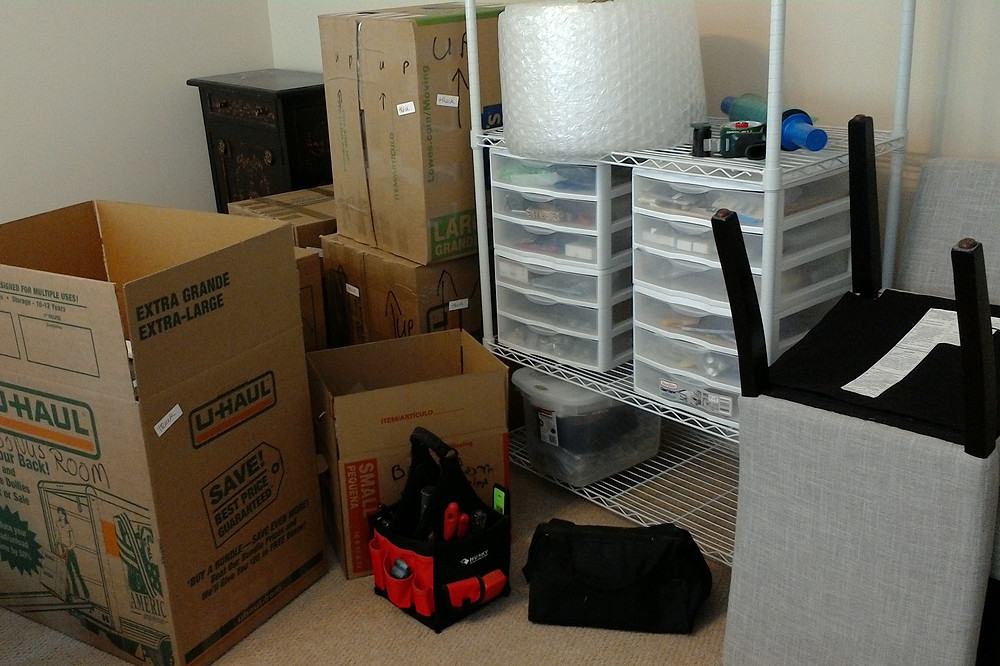 The workroom has turned into packing central to get ready f move.