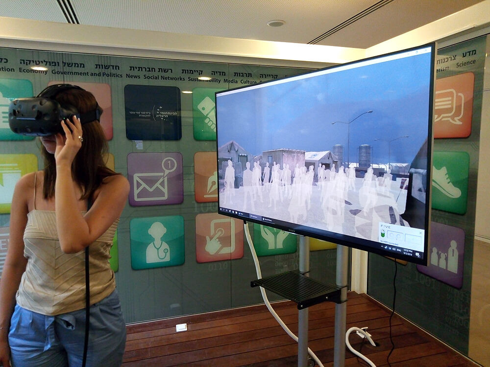 "A VR user watches ""Clouds over Sidra"" at the Advanced Virtual Reality lab, IDC Herzliya"