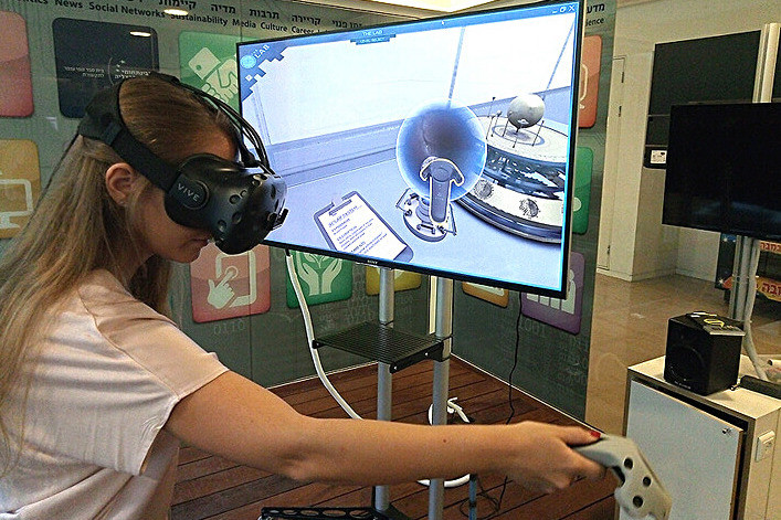 A VR user at the Advanced Virtual Reality lab at the Interdisciplinary Center Herzliya