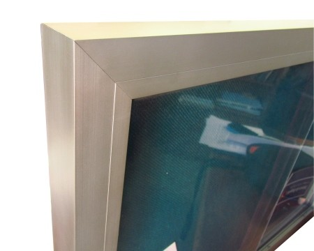 Cartelera con puertas corredizas en medellin