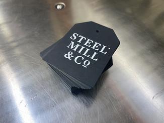 Steel Mill Black Tag