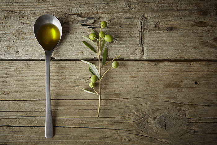 Olive Oil in a Spoon.