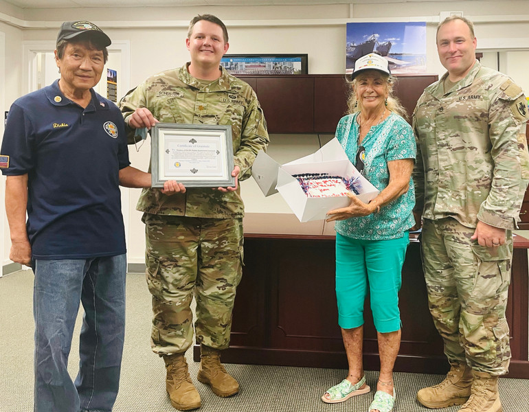 Certificate & Cake presented to 8 TSC fo