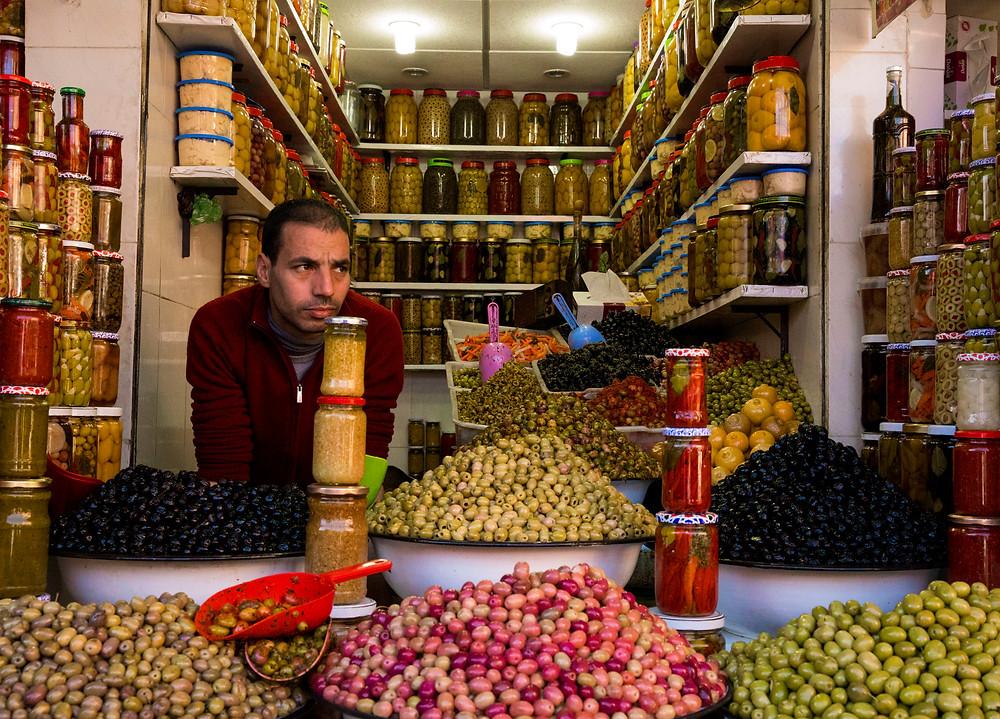 Olive vendor in the Old Medina, Marrakesh, Morocco