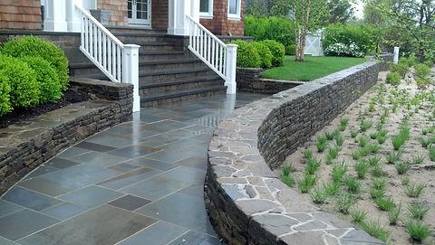 Bluestone walkway and stone retaining wall, project in Bridgehampton NY
