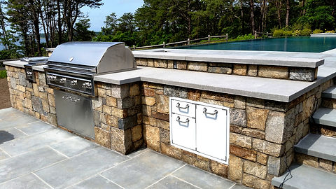 Custom stone Outdoor grill island with bluestone counter top, project in Southampton NY