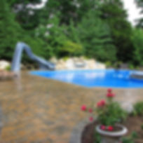 Cambridge Pavers Pool Deck set on concrete with Polymeric send swept joints. _www.castrostoneworks.j
