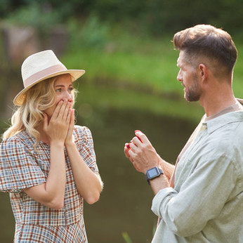 man-proposing-to-surprised-girlfriend-ou