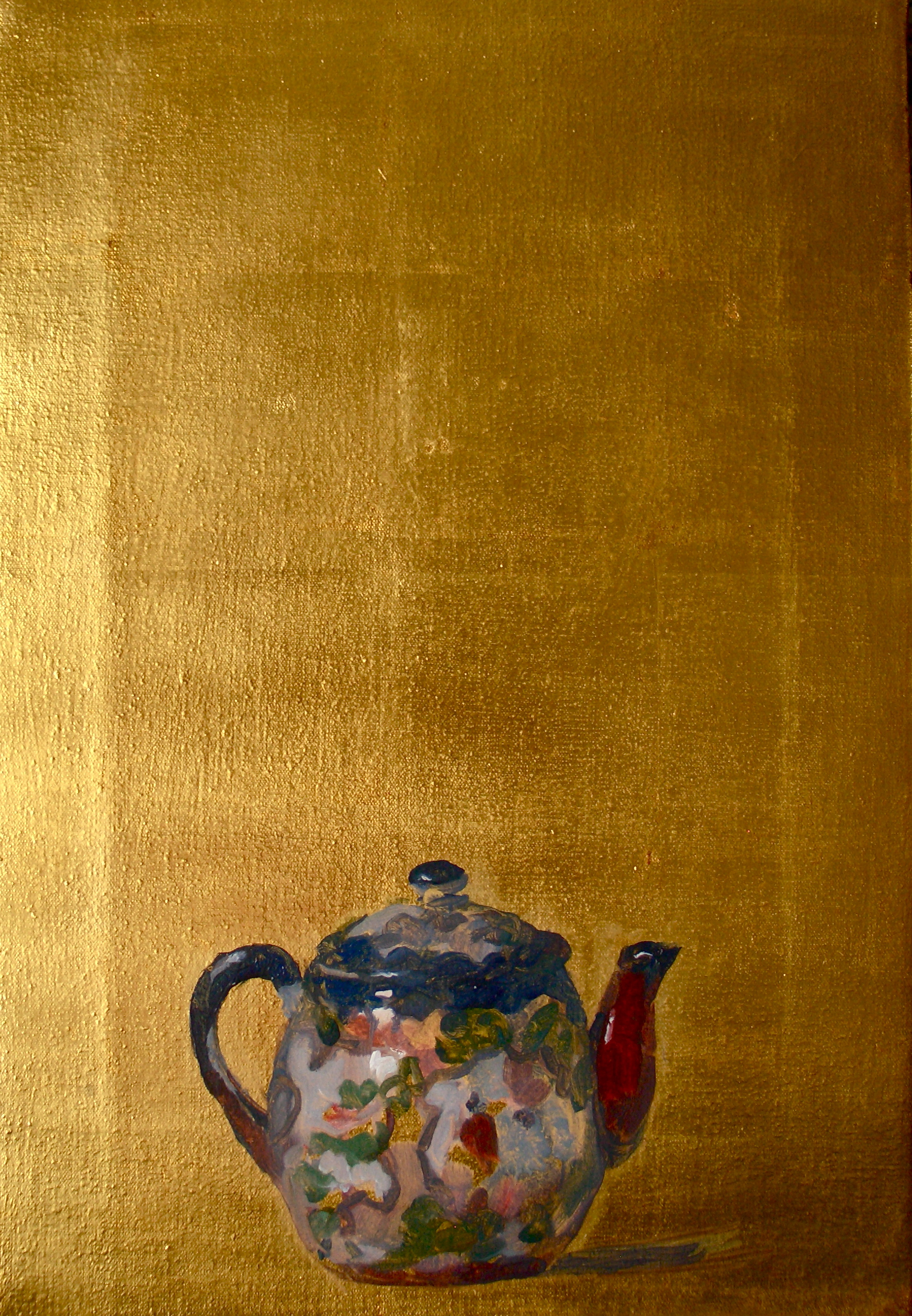 Teapot on gold