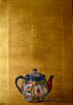 Teapot on gold