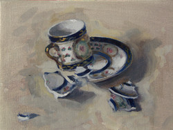 Broken cup and saucer