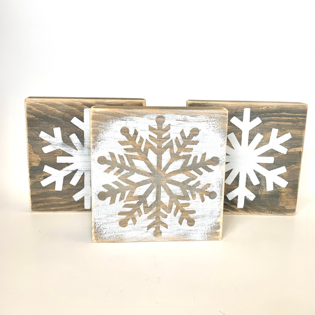 wood block with distressed snowflake
