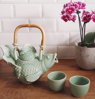 Fish shaped ceramic teapot and matching cups