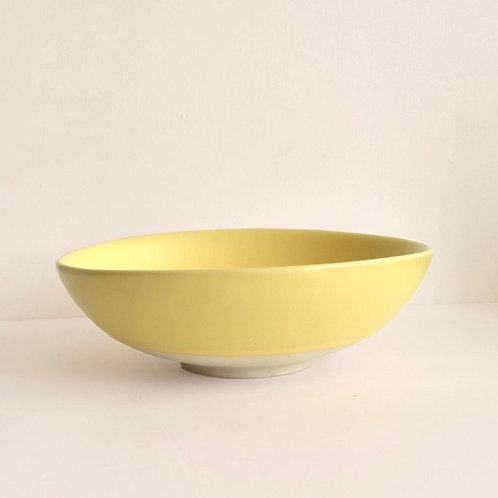 Yellow pasta bowl side view