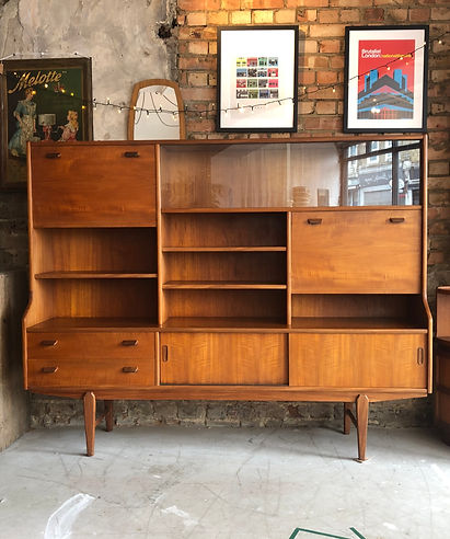 Large teak mid-century sideboard with multiple storage compartments
