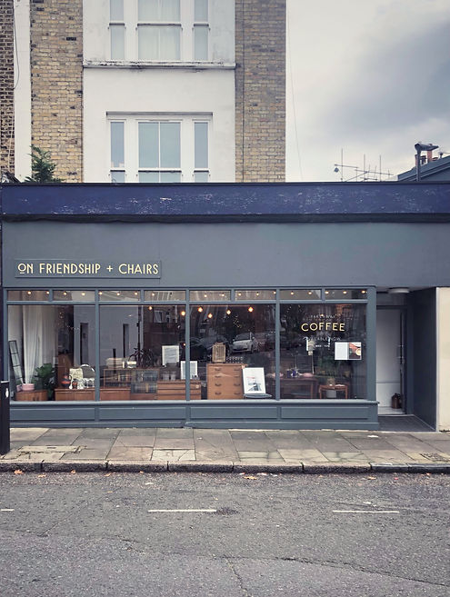 Blue grey shop front of On Friendship an