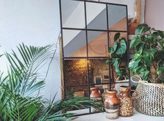 Window Frame Mirror with vases and plants