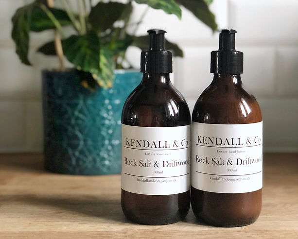 Hand wash and lotion in apothercary style glass bottles