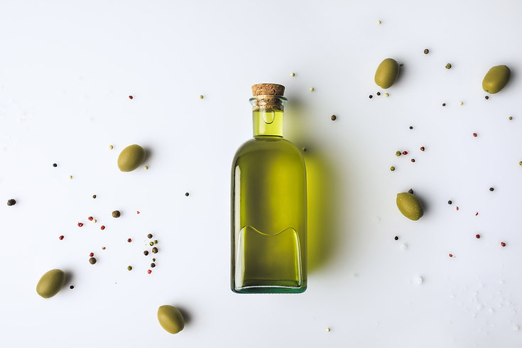 Top view of glass bottle with olive oil