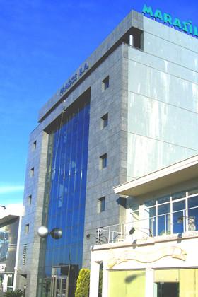 """Κτιριο γραφείων - καταστημάτων εταιρείας ' MARASIL"""" στην Αθήνα"""