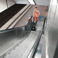 Escalator cleaner in action