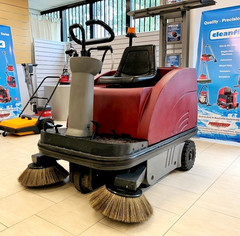 Compact sized industrial sweeper
