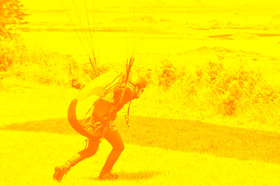 student foward launches a paraglider