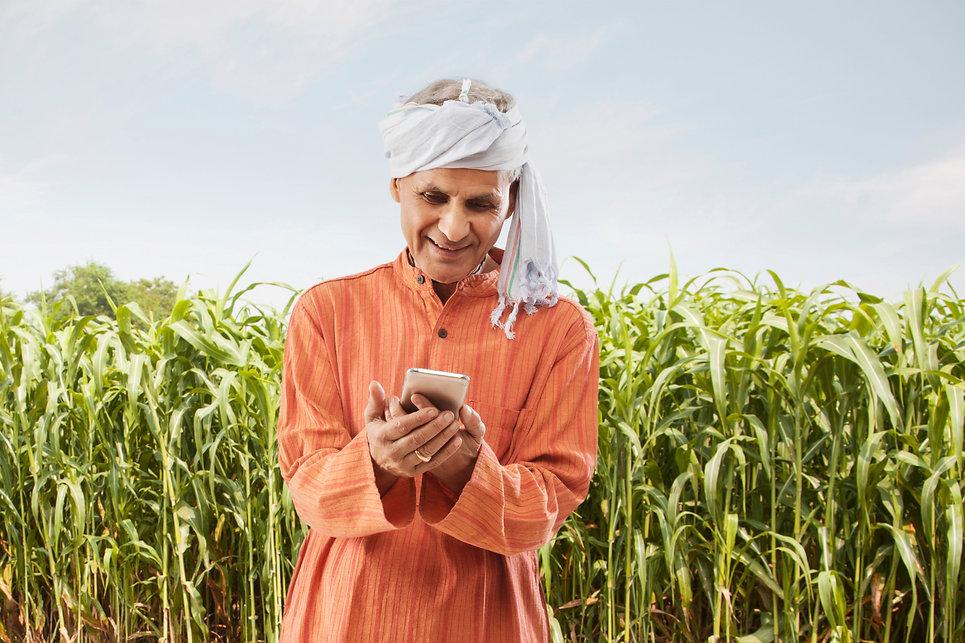 FarmerWithPhone.jpeg