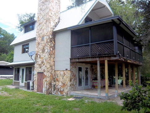 Custom home by Rise Construction covered balcony